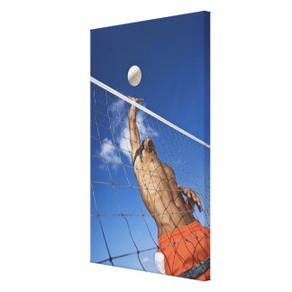 Man playing beach volleyball canvas print