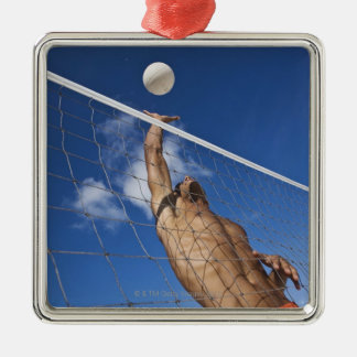 Man playing beach volleyball ornament