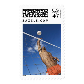 Man playing beach volleyball postage stamp