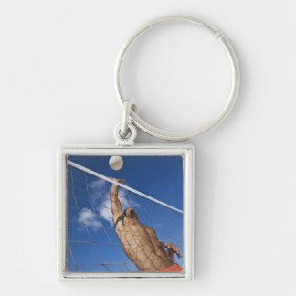 Man playing beach volleyball Silver-Colored square keychain