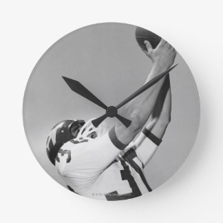 Man Playing Football Round Clock