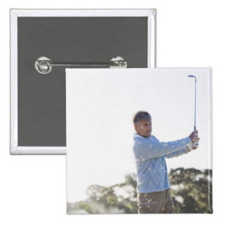 Man playing golf in sand trap 2 inch square button