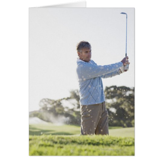 Man playing golf in sand trap card