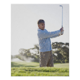 Man playing golf in sand trap poster