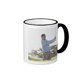 Man playing golf in sand trap ringer mug
