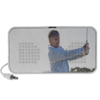Man playing golf in sand trap iPod speaker