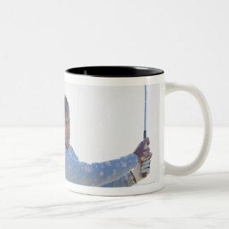 Man playing golf in sand trap Two-Tone coffee mug