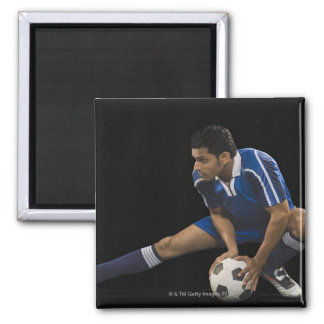 Man playing soccer magnet