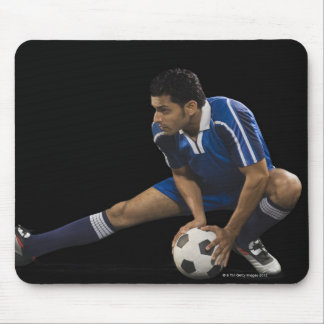 Man playing soccer mouse pad