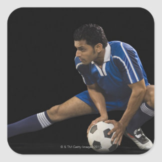 Man playing soccer square sticker