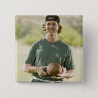 Man playing tag football button