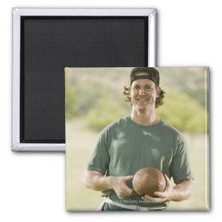 Man playing tag football magnet