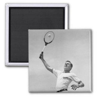 Man playing tennis fridge magnet