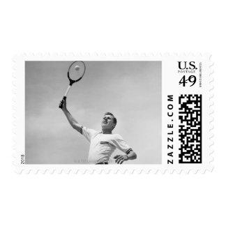 Man playing tennis postage