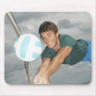Man playing volleyball on the beach mouse pad