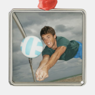 Man playing volleyball on the beach christmas tree ornaments