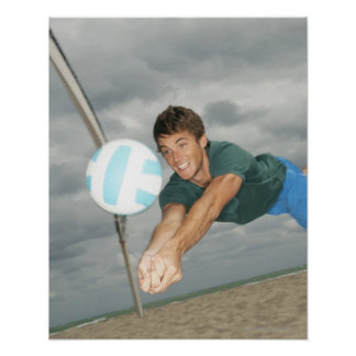 Man playing volleyball on the beach poster