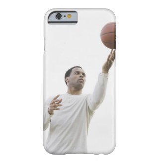 Man playing with basketball, studio shot barely there iPhone 6 case