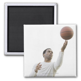 Man playing with basketball, studio shot magnet