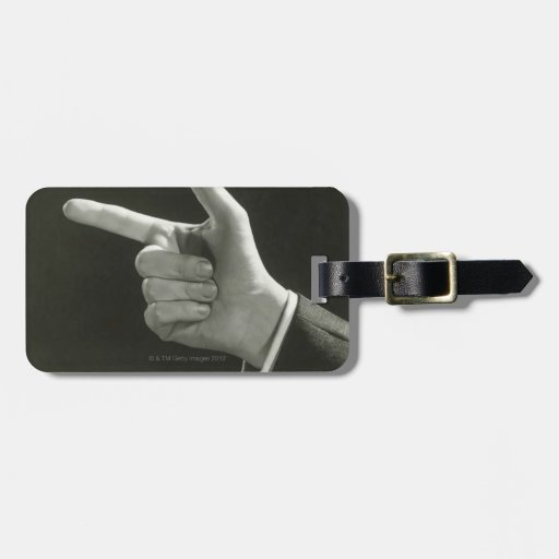 Man Pointing Luggage Tag