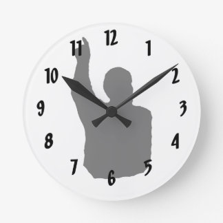 man pointing up shadow round clock