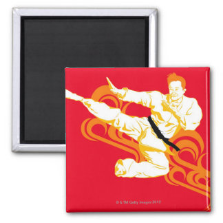 Man practicing martial arts, performing mid air 2 inch square magnet