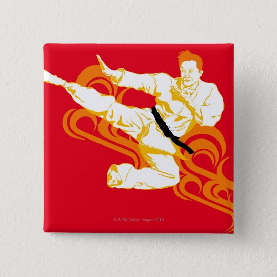 Man practicing martial arts, performing mid air button
