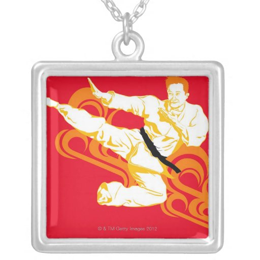 Man practicing martial arts, performing mid air square pendant necklace