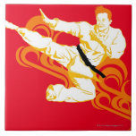 Man practicing martial arts, performing mid air large square tile