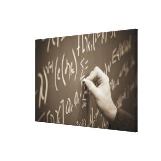 Man printing math equations on a chalkboard canvas print