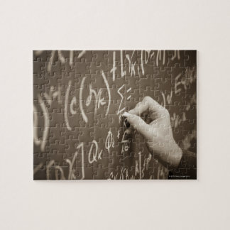 Man printing math equations on a chalkboard jigsaw puzzle