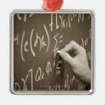 Man printing math equations on a chalkboard metal ornament