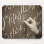 Man printing math equations on a chalkboard mouse pad