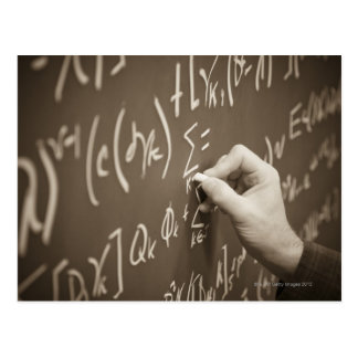 Man printing math equations on a chalkboard postcard