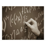 Man printing math equations on a chalkboard poster