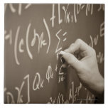 Man printing math equations on a chalkboard large square tile