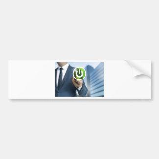 Man pushes power button concept background bumper sticker