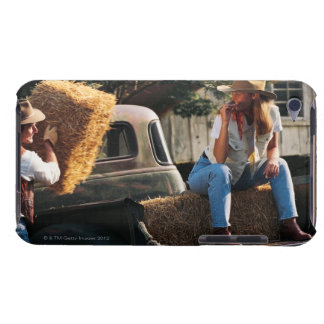 Man putting hay bales in truck with woman barely there iPod cover