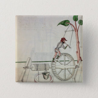 Man Putting into Motion a Wheel-Driven Well Pinback Button