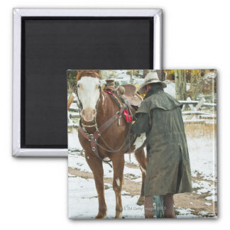 Man putting saddle on horse 2 inch square magnet
