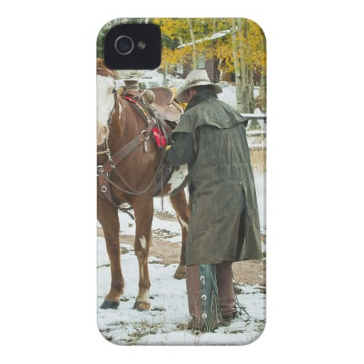 Man putting saddle on horse Case-Mate iPhone 4 cases