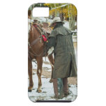 Man putting saddle on horse iPhone 5 covers