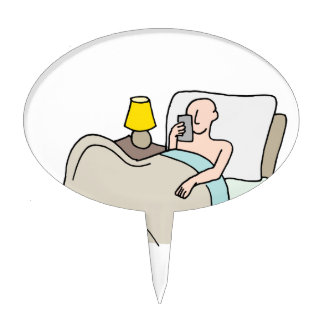 Man reading his phone in bed cake topper