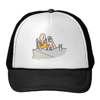 Man reading his phone while eating trucker hat