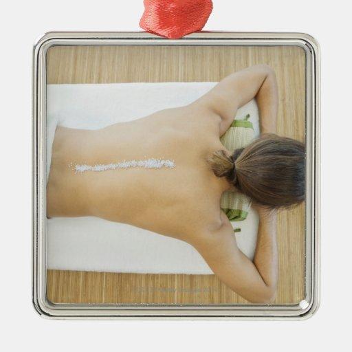 Man receiving spa treatment ornaments