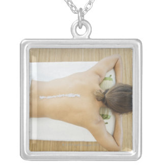 Man receiving spa treatment silver plated necklace