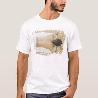 Man receiving spa treatment T-Shirt