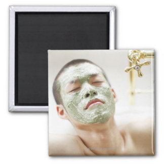 Man Relaxing in a Bathtub with a Facial Mask 2 Inch Square Magnet
