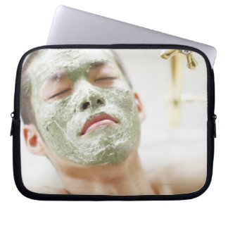 Man Relaxing in a Bathtub with a Facial Mask Laptop Sleeve