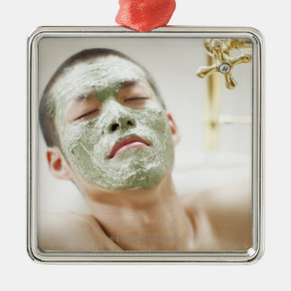 Man Relaxing in a Bathtub with a Facial Mask Metal Ornament